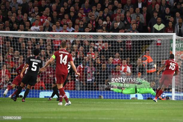 Paris SaintGermain's French goalkeeper Alphonse Areola saves a shot from Liverpool's Egyptian midfielder Mohamed Salah during the UEFA Champions...