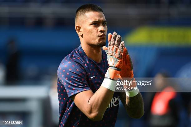 Paris SaintGermain's French goalkeeper Alphonse Areola warms up ahead of the French L1 football match Paris SaintGermain vs Angers on August 25 2018...