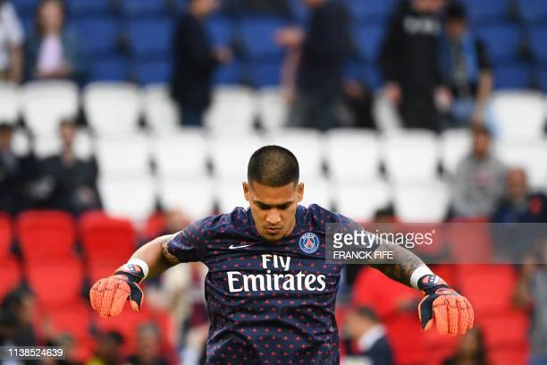 Paris SaintGermain's French goalkeeper Alphonse Areola warms up prior to the French L1 football match between Paris SaintGermain and Monaco on April...