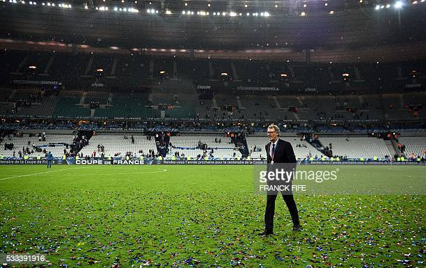 Paris Saint-Germain's French head coach Laurent Blanc walks on the football field after his team won the French Cup final football match against...