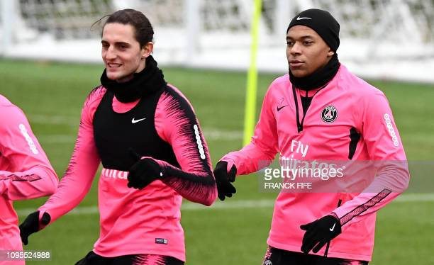 Paris SaintGermain's French midfielder Adrien Rabiot and Paris SaintGermain's French forward Kylian Mbappe take part in a training session at the...