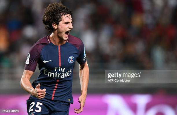 Paris SaintGermain's French midfielder Adrien Rabiot celebrates after scoring a goal during the French Trophy of Champions football match between...