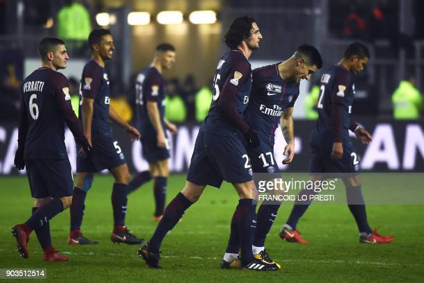 Paris SaintGermain's French midfielder Adrien Rabiot celebrates with teammates after scoring a goal during the French League Cup quarterfinal...