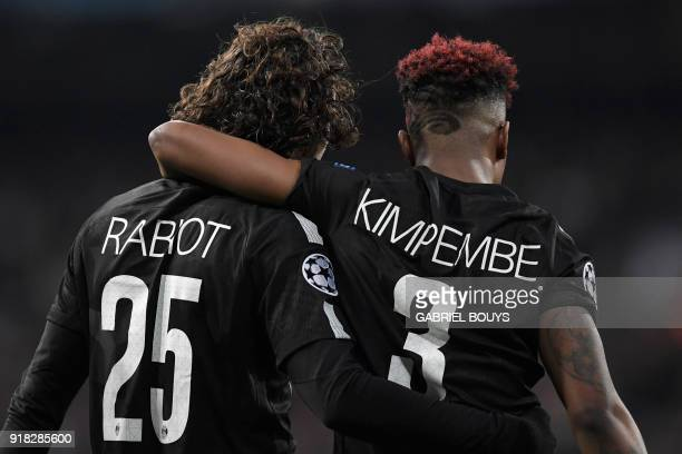 Paris SaintGermain's French midfielder Adrien Rabiot celebrates with Paris SaintGermain's French defender Presnel Kimpembe after scoring during the...