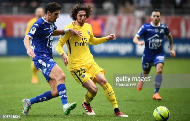 Paris SaintGermain's French midfielder Adrien Rabiot controls the ball during the French L1 football match between Troyes and Paris SaintGermain at...