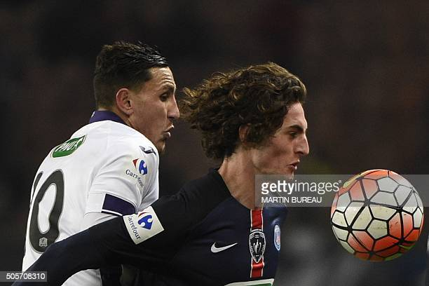 Paris SaintGermain's French midfielder Adrien Rabiot fights for the ball with Toulouse's FrenchMoroccan midfielder Adrien Regattin during the French...