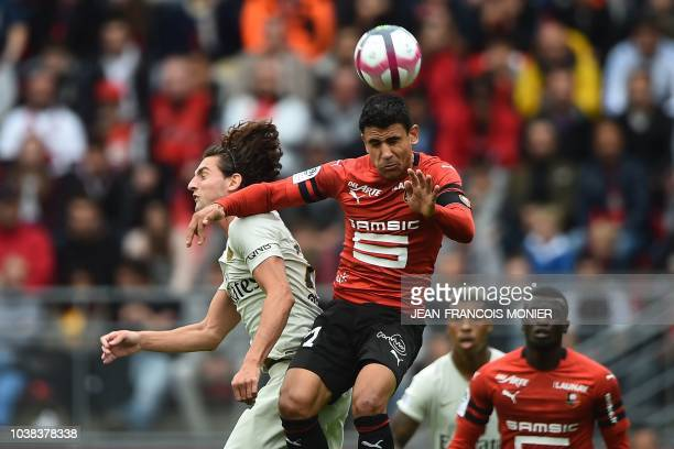 Paris SaintGermain's French midfielder Adrien Rabiot heads the ball with Rennes' French midfielder Benjamin Andre during the French L1 football match...