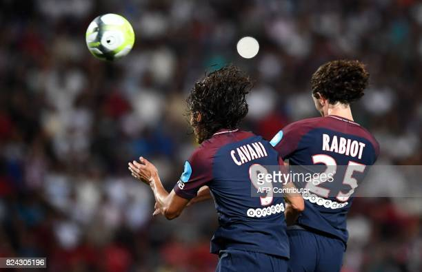 Paris SaintGermain's French midfielder Adrien Rabiot heads the ball and scores a goal during the French Trophy of Champions football match between...