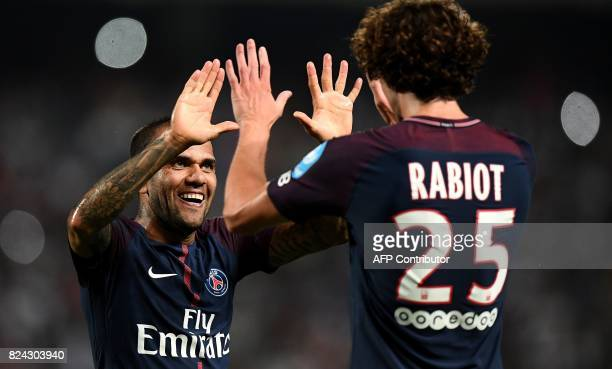 TOPSHOT Paris SaintGermain's French midfielder Adrien Rabiot is congratuled by Paris SaintGermain's Brazilian defender Dani Alves after scoring a...