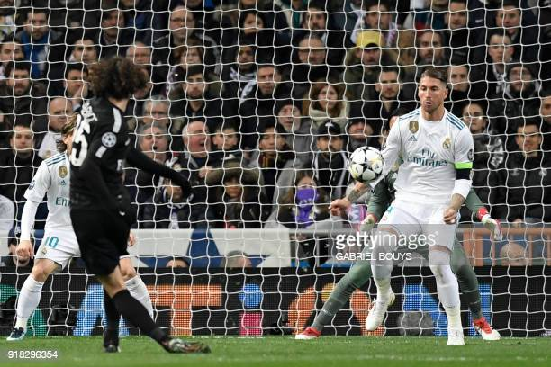 Paris Saint-Germain's French midfielder Adrien Rabiot kicks the ball in front of Real Madrid's Spanish defender Sergio Ramos during the UEFA...