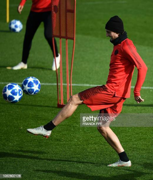Paris SaintGermain's French midfielder Adrien Rabiot plays the ball during a training session of the Paris SaintGermain football team on October 23...