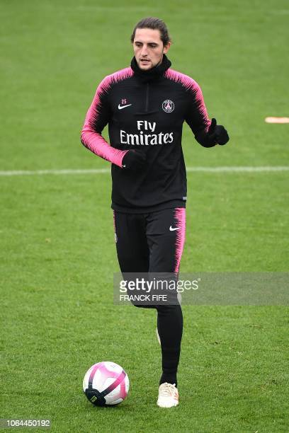 Paris SaintGermain's French midfielder Adrien Rabiot plays the ball during a training session at the team's 'Camp des Loges' training grounds in...