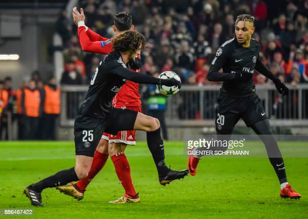 Paris SaintGermain's French midfielder Adrien Rabiot plays the ball past Paris SaintGermain's French defender Layvin Kurzawa during the UEFA...