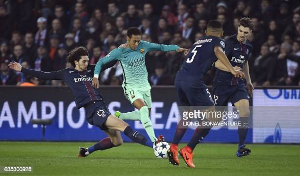 TOPSHOT Paris SaintGermain's French midfielder Adrien Rabiot tackles Barcelona's Brazilian forward Neymar during the UEFA Champions League round of...