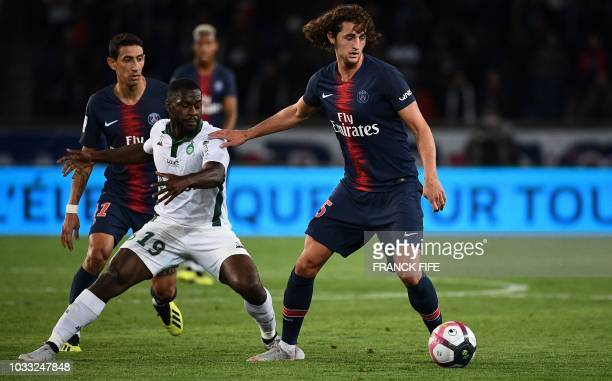 Paris Saint-Germain's French midfielder Adrien Rabiot vies for the ball with Paris Saint-Germain's French midfielder Lassana Diarra during the French...