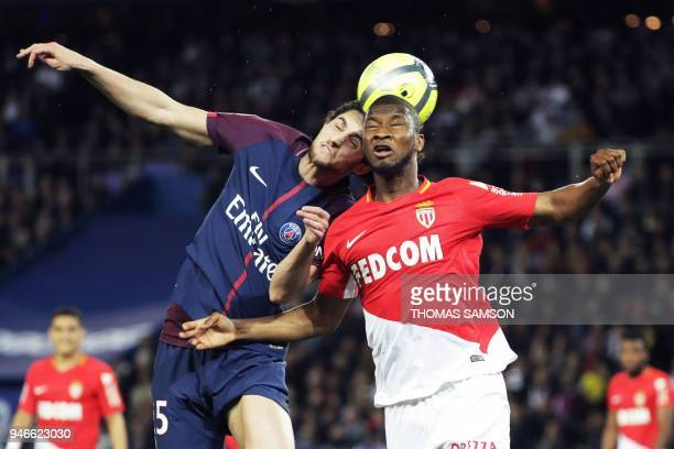 Paris Saint-Germain's French midfielder Adrien Rabiot vies for the ball with Monaco's Malian defender Almamy Toure during the French L1 football...