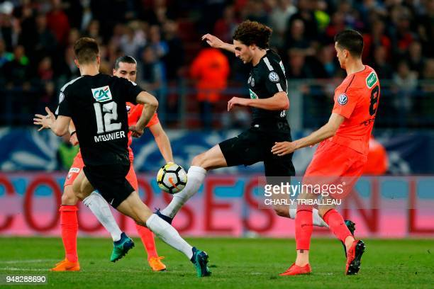 Paris SaintGermain's French midfielder Adrien Rabiot vies for the ball with Caen's French forward Enzo Crivelli and Caen's Belgian midfielder Steef...