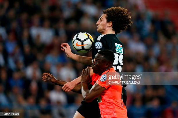 Paris SaintGermain's French midfielder Adrien Rabiot vies for the ball with Caen's Haitian defender Romain Genevois during the French cup semifinal...