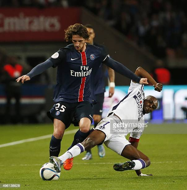 Paris SaintGermain's French midfielder Adrien Rabiot vies with Toulouse's French Ivorian defender Jean AkpaAkpro during the French L1 football match...