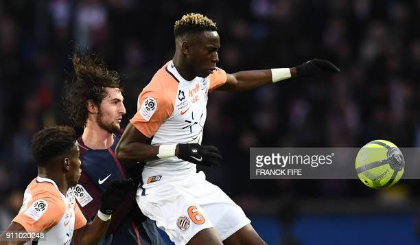 Paris SaintGermain's French midfielder Adrien Rabiot vies with Montpellier's French midfielder Junior Sambia during the French L1 football match...