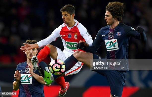 TOPSHOT Paris SaintGermain's French midfielder Adrien Rabiot vies with Monaco's French forward Dylan Beaulieu during the French Cup semifinal match...