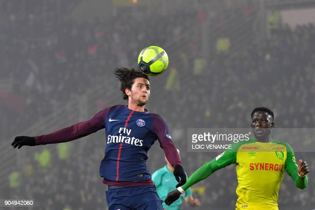 Paris SaintGermain's French midfielder Adrien Rabiot vies with Nantes' French midfielder Abdoulaye Toure during the French L1 football match between...