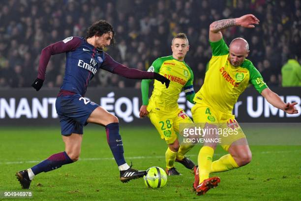 Paris SaintGermain's French midfielder Adrien Rabiot vies with Nantes' French defender Nicolas Pallois during the French L1 football match between...