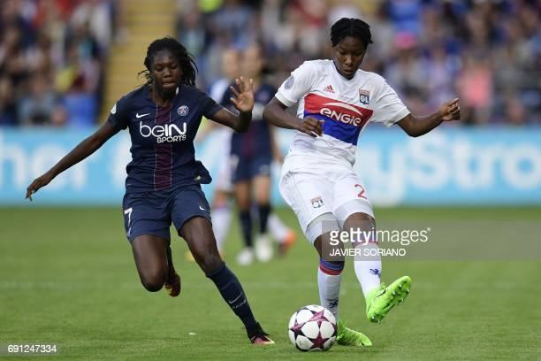 Paris SaintGermain's French midfielder Aminata Diallo vies with Lyon's Canadian defender Kadeisha Buchanan during the UEFA Women's Champions League...