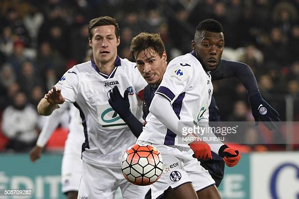 Paris SaintGermain's French midfielder Benjamin Stambouli vies for the ball with Toulouse's FrenchBurkinabe defender Steeve Yago and Toulouse's...