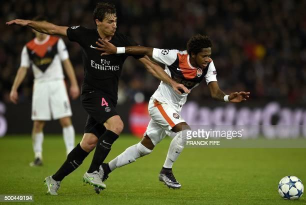 Paris SaintGermain's French midfielder Benjamin Stambouli vies with Shakhtar Donetsk's Brazilian midfielder Fred during the UEFA Champions League...