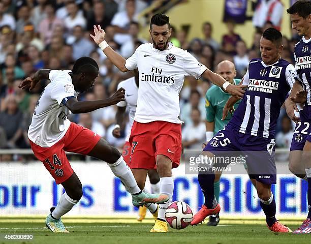 Paris SaintGermain's French midfielder Blaise Matuidi and Paris SaintGermain's Argentinian midfielder Javier pastore vies with Toulouse's Romanian...