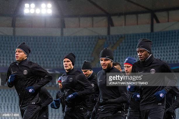Paris SaintGermain`s French midfielder Blaise Matuidi French defender Layvin Kurzawa Uruguayan forward Edinson Cavani and Dutch defender Gregory Van...