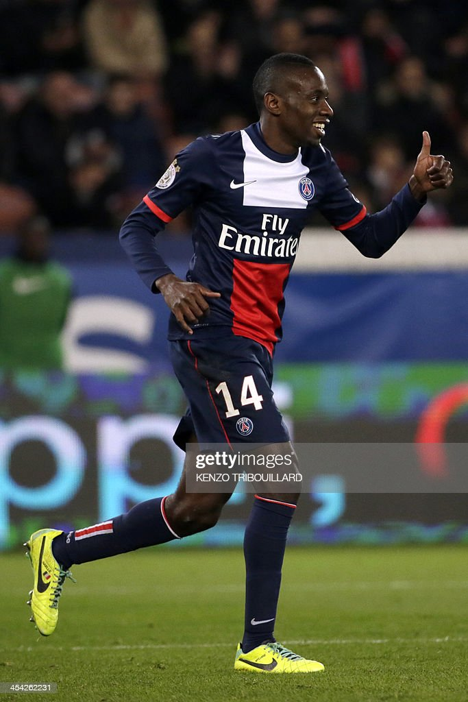 Paris Saint-Germain's French midfielder Blaise Matuidi gives a thumbs-up during the French L1 football match between Paris Saint-Germain and Sochaux at the Parc des Princes Stadium in Paris on December 7, 2013.