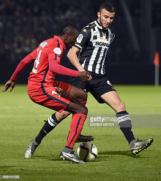 Paris SaintGermain's French midfielder Blaise Matuidi vies for the ball with Angers' Moroccan midfielder Romain Saiss during the French L1 football...