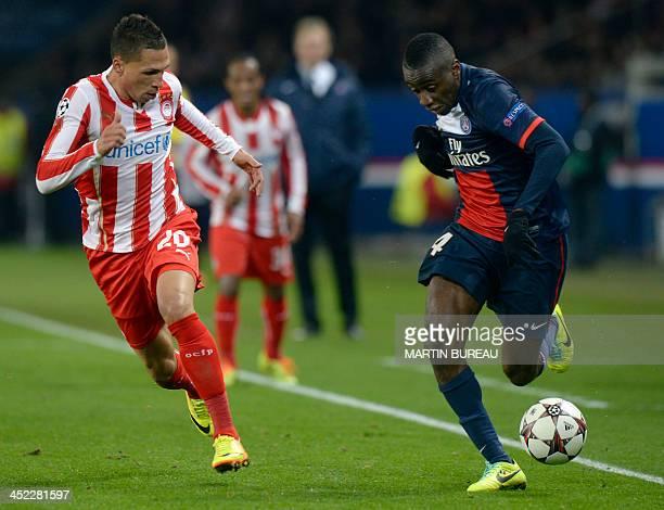 Paris SaintGermain's French midfielder Blaise Matuidi vies with Olympiakos' Greek defender Jose Holebas during an UEFA Chanpions League group C...