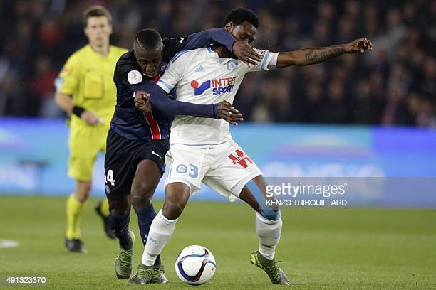 Paris SaintGermain's French midfielder Blaise Matuidi vies with Marseille's Cameroonian defender Nicolas Nkoulou during the French L1 football match...