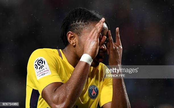 Paris SaintGermain's French midfielder Christopher Nkunku celebrate after scoring a goal during the French L1 football match between Troyes and Paris...