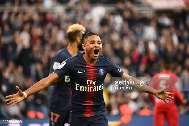 Paris SaintGermain's French midfielder Christopher Nkunku celebrates scoring his team's first goal during the French L1 football match between Paris...