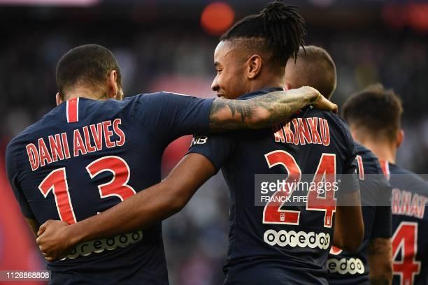 Paris SaintGermain's French midfielder Christopher Nkunku celebrates scoring his team's first goal with Paris SaintGermain's Brazilian defender Dani...