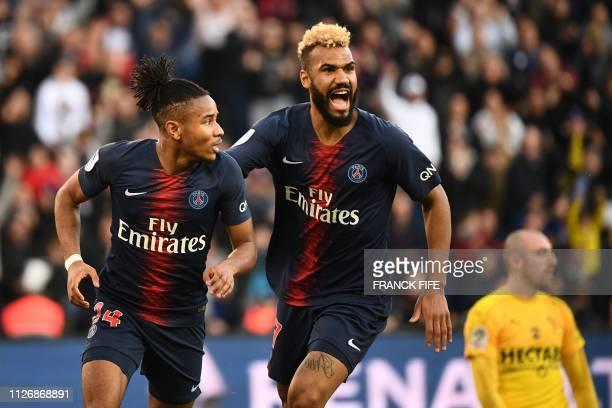 Paris SaintGermain's French midfielder Christopher Nkunku celebrates scoring his team's first goal with Paris SaintGermain's Cameroonian forward Eric...