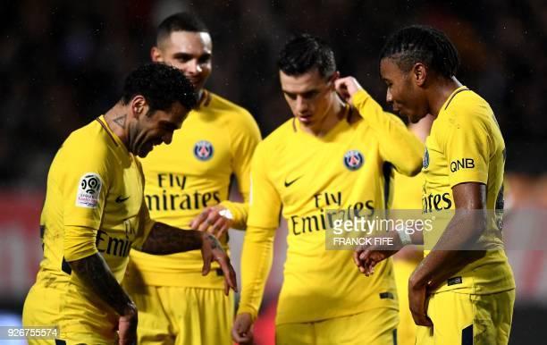 Paris SaintGermain's French midfielder Christopher Nkunku celebrates his goal with Paris SaintGermain's Brazilian defender Dani Alves Paris...