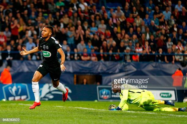 Paris SaintGermain's French midfielder Christopher Nkunku celebrates after scoring during the French cup semifinal match between Caen and Paris...