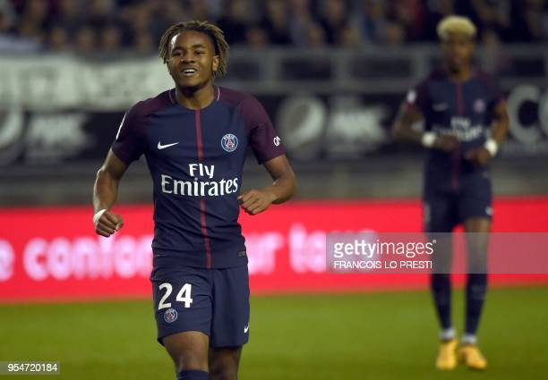 Paris SaintGermain's French midfielder Christopher Nkunku celebrates after scoring during the French L1 football match between Amiens and PSG on May...