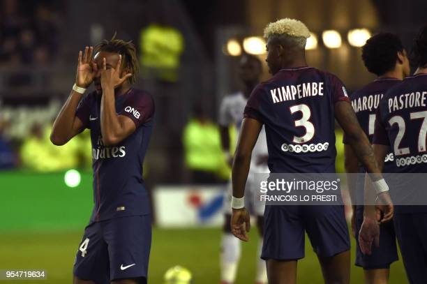 Paris SaintGermain's French midfielder Christopher Nkunku is congratuled by teammates after scoring during the French L1 football match between...
