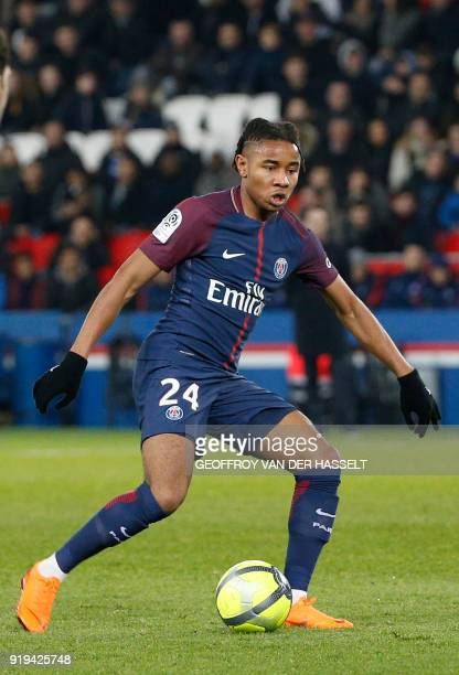 Paris SaintGermain's French midfielder Christopher Nkunku kicks the ball during the French Ligue 1 football match between Paris SaintGermain and...