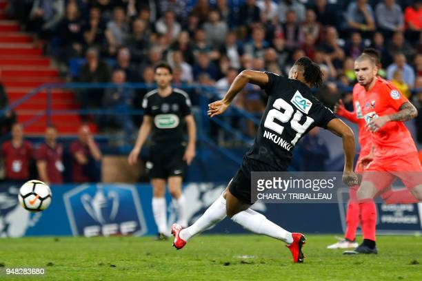 Paris SaintGermain's French midfielder Christopher Nkunku scores during the French cup semifinal match between Caen and Paris SaintGermain on April...
