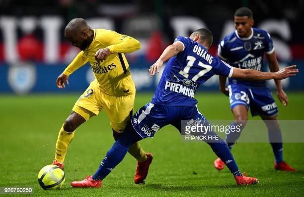 Paris SaintGermain's french midfielder Lassana Diarra vies with Troyes' Gabonese defender Johann Obiang during the French L1 football match between...