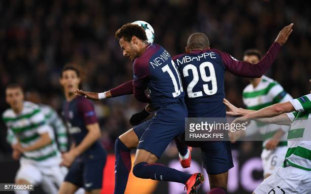 Paris SaintGermain's French striker Kylian Mbappe and teammate Brazilian striker Neymar collide during the UEFA Champions League Group B football...