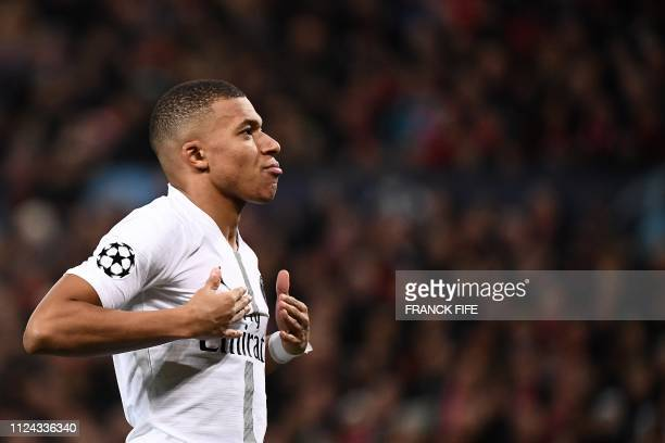TOPSHOT Paris SaintGermain's French striker Kylian Mbappe celebrates scoring his team's second goal during the first leg of the UEFA Champions League...