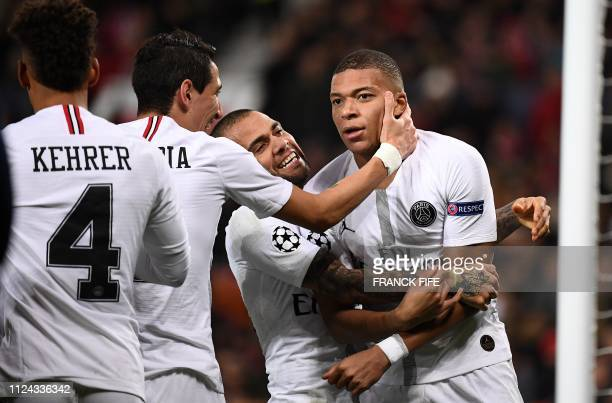 Paris SaintGermain's French striker Kylian Mbappe celebrates scoring his team's second goal during the first leg of the UEFA Champions League round...